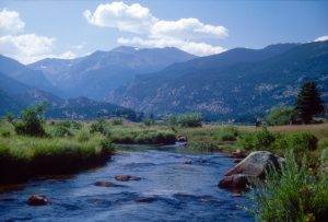 A stream emerges from the mountains in Colorado's Rocky Mountain National Park.
